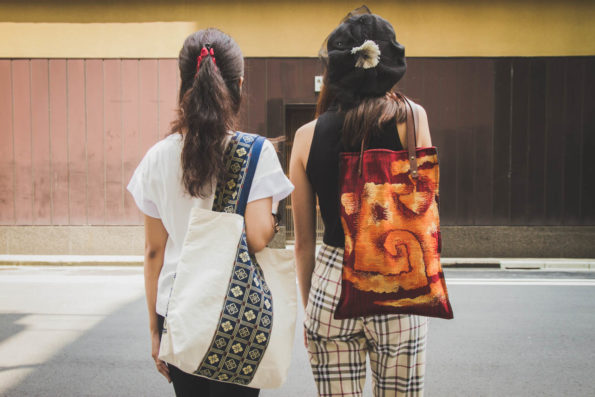 Backview of two models with large totes