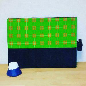 Bespoke laptop sleeve made from Japanese denim and green and orange obi
